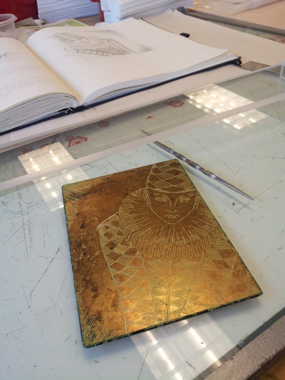 Etching the plate.